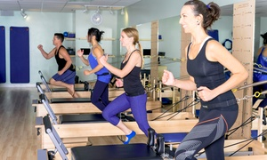 Pilates V: Five Pilates Classes or One Month of Unlimited Classes at Pilates V (Up to 66% Off)