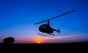 HeliBacon: $700 for a One-Hour Helicopter Tour for Up to Three Passengers from HeliBacon ($1,000 Value)