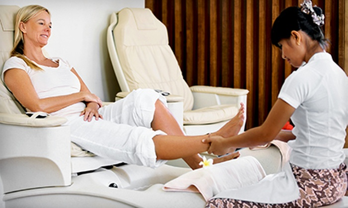 Skin Essence A Day Spa - North Raleigh: Signature or Shellac Manicure with Chocolate or Peppermint Pedicure at Skin Essence A Day Spa (Up to 65% Off)