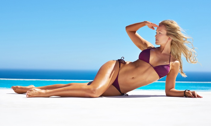 Beach Beautiful - Multiple Locations: $129 for Two Electro Body Sculpting Sessions at Beach Beautiful ($300 Value)