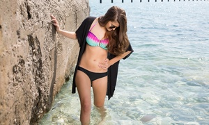 Beaches Tanning - Sandy Location: Three Mystic Spray Tans or One Week of Tanning with One Mystic Spray Tan at Beaches Tanning (Up to 93% Off)