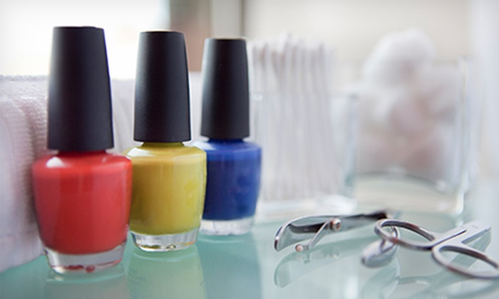 Studio M Beauty Boutique - Manor Section: Basic Mani with Spa Pedi or Spa Mani-Pedi with Optional Brow and Lip Wax at Studio M Beauty Boutique (Up to 73% Off)
