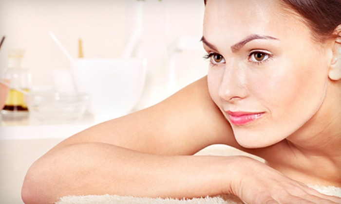 White Dahlia - North Raleigh: Custom Skin-Balancing Facial or 60- or 90-Minute Massage with Aromatherapy at White Dahlia (Up to 53% Off)
