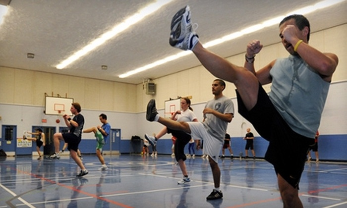 Grind Athletix - Riley Park: $40 for One Month of Boot-Camp Classes at Grind Athletix ($140 Value)