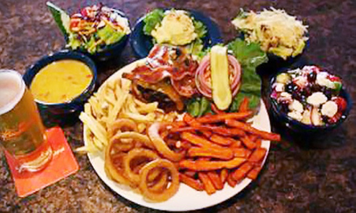 Woody's Pub - Highway 97: $15 for $30 Worth of Pub Fare at Woody's Pub