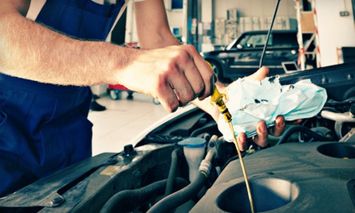 Diffee Motor Company - Suburban Northside: One or Three Oil Changes with a Tire Rotation, or a Transmission Flush at Diffee Motor Company (Up to 53% Off)