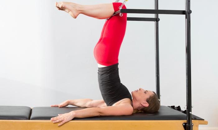 Symmetry In Motion - Las Vegas: Four Pilates Reformer Classes at Symmetry In Motion LV (75% Off)