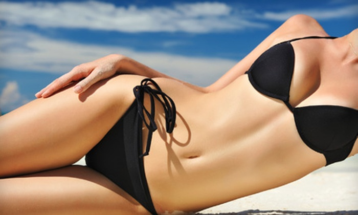 Rock It Tan - Fort Worth: Two Spray Tans, One Month of Red-Light Therapy, or One Month of UV Tanning at Rock It Tan (Up to 64% Off)