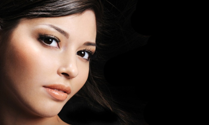 AbFab Salon and Spa - Southeast: Haircut and Treatment or Eyelash Enhancements at AbFab Salon and Spa