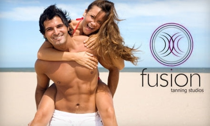 Fusion Tanning - Multiple Locations: $15 for One Month of Unlimited Tanning ($39.95 Value) or $20 for Two Mystic Tan Sessions ($50 Value) at Fusion Tanning