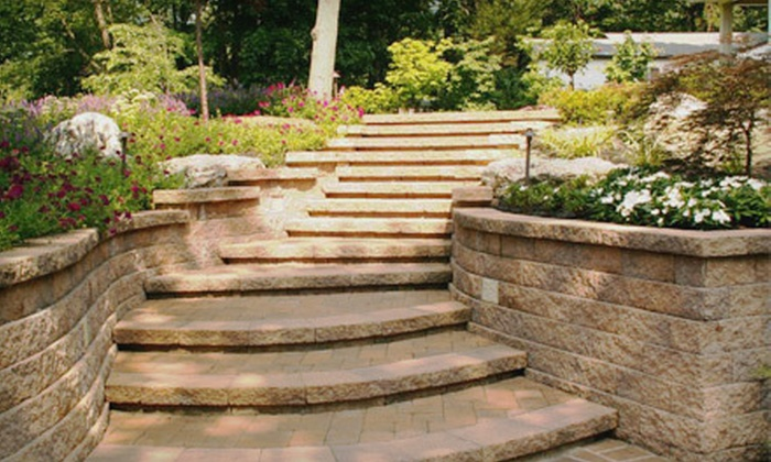 One Guy and a Machine - Downtown: Landscape and Hardscape Services from One Guy and a Machine (Up to 60% Off). Three Options Available.