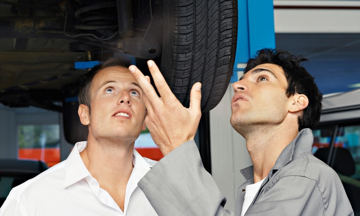 Duluth Tire Outlet & Auto Repair - Duluth Tire Outlet & Auto Repair: Full-Service Oil Change, or a Two- or Four-Wheel Alignment atDuluth Tire Outlet & Auto Repair(Up to 62% Off)