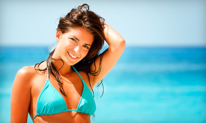 Southern Rays Tanning - Multiple Locations: $19 for Two Spray Tans or One Month of Unlimited Level 1 UV-Tanning Sessions at Southern Rays Tanning (Up to $63 Value)