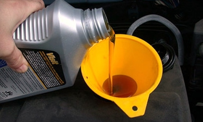 Sallas Auto Repair - Multiple Locations: $25 for Two Oil Changes and a 52-Point Inspection at Sallas Auto Repair