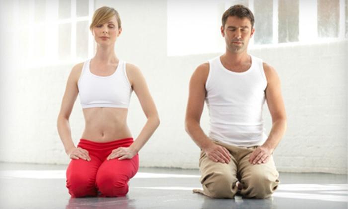 Hot Yoga Tacoma - North End: $45 for 10 90-Minute Classes at Hot Yoga Tacoma ($105 Value)
