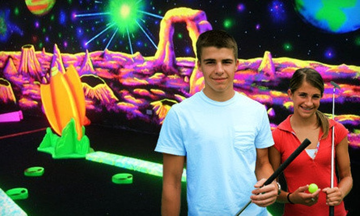 Space Golf - Orland Park: 18-Hole Black-Light Mini Golf for Four with Option for 3-D Gaming Package at Space Golf in Orland Park (Up to 54% Off)