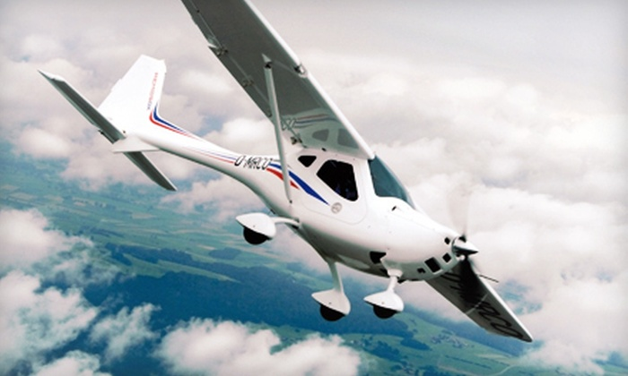 SimplyFLY - Sugar Grove: Ground School and Discovery Flight for One, Two, or Three, or an Intro to Flying Package at SimplyFLY (Up to 60% Off)