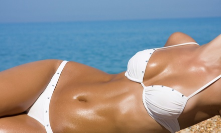 One or Three Spray Tans or One or Six Months of Tanning in Ultimate Envy 134 Bed at HudSun Tans (Up to 52% Off)