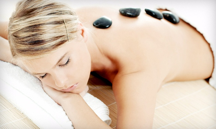 Massage Retreat & Spa - Multiple Locations: Hot-Stone Massage, Facial, or Spa Package with Massage and Facial at Massage Retreat & Spa (Up to 52% Off)