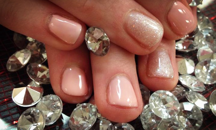 At Your Fingertips Nails & Esthetics - Central City: Express Mani-Pedi with Optional Shellac Polish at At Your Fingertips (Up to 50% Off)