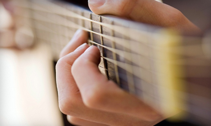 RockHome Lessons - San Diego: Two or Four 30-Minute In-Home Private Guitar Lessons with a RockStarter Materials Kit from RockHome Lessons