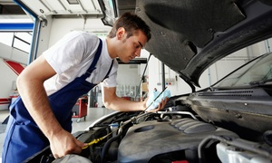 Mike's Motors: One Basic Oil Change with Optional Tire Rotation at Mike's Motors (Up to 50% Off)