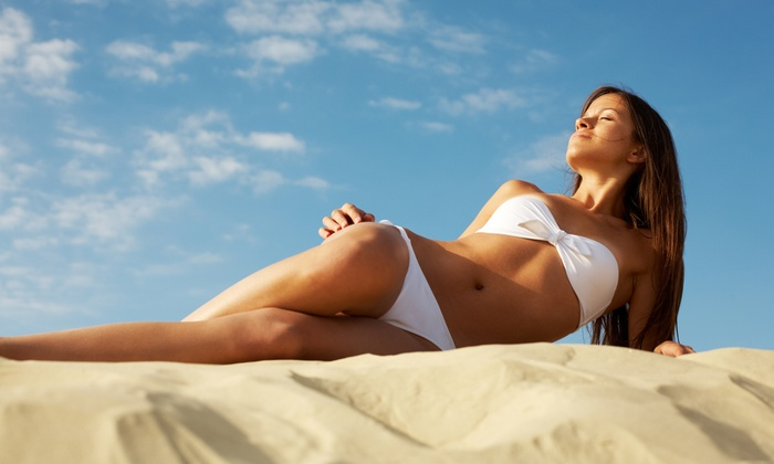 Glowing Gold Tanning Spa - Hialeah: $21 for 2 VersaSpa Spray Tans or 1 Week of UV Tanning at Glowing Gold Tanning Spa (Up to $126 Value)