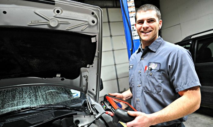 DK Motors - Columbia: One or Three Oil-Change Packages or Winterization Package at DK Motors (Up to 53% Off)