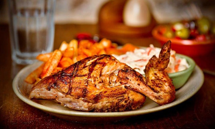 Nando's Peri-Peri - Multiple Locations: $12 for $20 Worth of Afro-Portuguese Cuisine at Nando's Peri-Peri