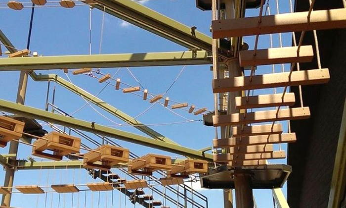 Spare Time - Lansing: Ropes Course Package for Two or Ropes Course Package for Four with Pizza and Soda at Spare Time (50% Off)