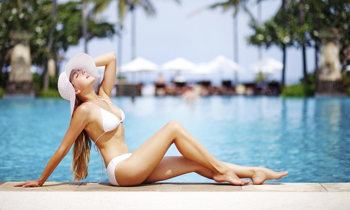 Vegas Sun Tan - Spanish Trail: 1 or 3 VersaSpa Spray Tans, or 1 Month of Unlimited Level-6 or -3 UV Tanning at Vegas Sun Tan (Up to 79% Off)