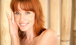 Bombshell Salon : Haircut with Optional Partial or Full Highlights or All-Over Color at Bombshell Salon (Up to 68% Off)
