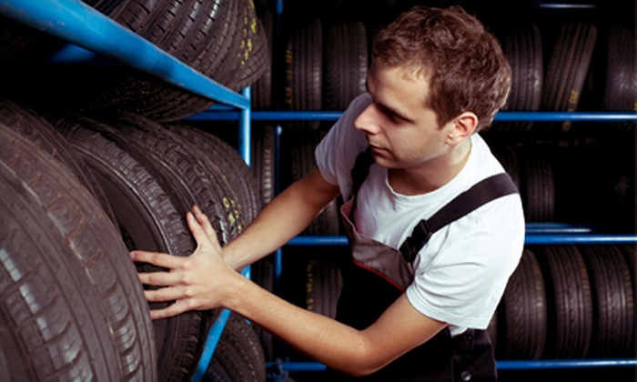 Dolphin Tires - Multiple Locations: Regular- or Synthetic-Oil-Change Package, a Brake Service, or a Four-Tire Alignment at Dolphin Tires (Up to 75% Off)