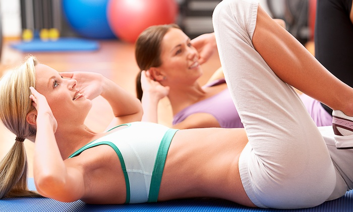 American Woman Fitness Centers - Multiple Locations: Women's-Gym Membership with or without Child Care at American Woman Fitness Centers (Up to 74% Off)