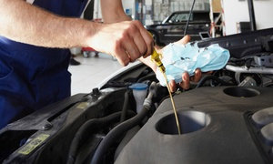 Auto Plus: Deluxe Oil-Change Package or Full Synthetic Oil Change Package at Auto Plus (Up to 54% Off)