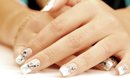 $27 for a Deluxe Manicure and Deluxe Pedicure at Salon Palomo & Day Spa ($70 Value)