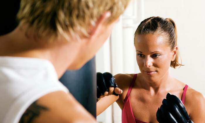 Title Boxing Club - Marion: $19 for Two Weeks of Unlimited Boxing and Kickboxing Classes with Hand Wraps at Title Boxing Club ($40 Value)