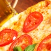 Up to 53% Off Pizza and Beer at The Green Parrot Bar & Grill