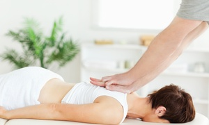 100% Chiropractic: Chiropractic Package with One-Hour Massage, and One or Four Adjustments at 100% Chiropractic (Up to 70% Off)