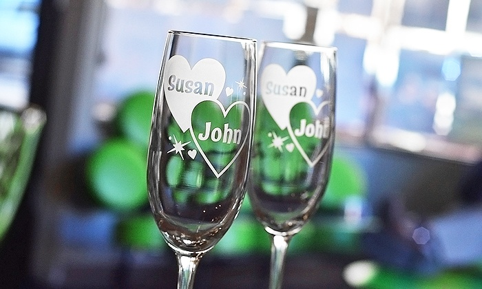 Glass with a Twist: $19.99 for Two Personalized Champagne Flutes from Glass with a Twist ($41.95 Value)