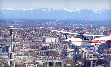 Half-Hour Flight Tour for up to 3 People and 1 Glass of Champagne for Each Drinking-Age Passenger (a $259 value) - Seattle Scenic Flights in Seattle