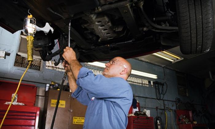 Brake King - Multiple Locations: Oil Change and Filter or Pothole Damage Repair at Brake King