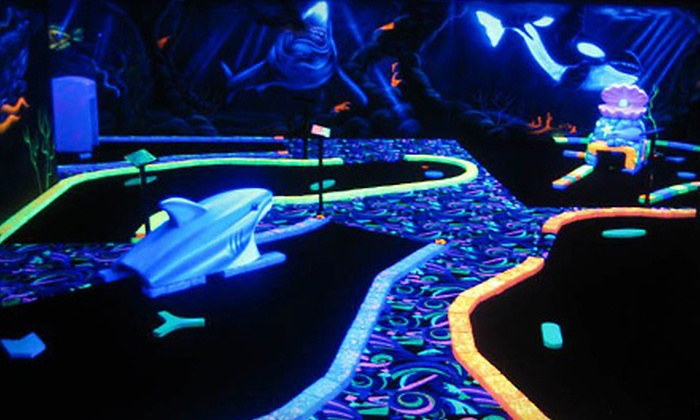 U-Puttz Black Light Miniature Golf - Weston Shops: $10 for Mini Golf Plus Bracelets and Necklaces for Two at U-Puttz Black Light Miniature Golf (Up to $20 Value)