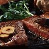 Half Off Steakhouse Fare at Passport Restaurant