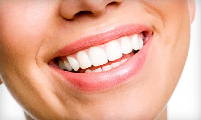 Smile Arts of NY - Midtown South Central: Zoom Teeth Whitening or Complete Dental-Implant Procedure at Smile Arts of NY (Up to 79% Off)