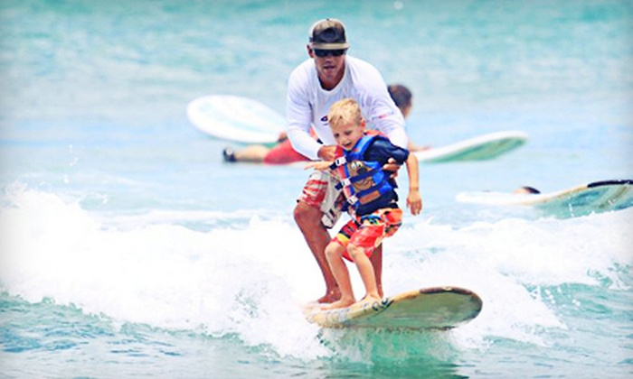 Big Wave Dave Surf Co. - Waikiki: Group Surf Lesson and Outrigger-Canoe Outing for One, Two, or Four at Big Wave Dave Surf Co. (Half Off)