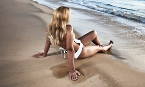 Suddenly Sunless: Custom Airbrush Tan or Pura Spray Session at Suddenly Sunless (Up to 52% Off)