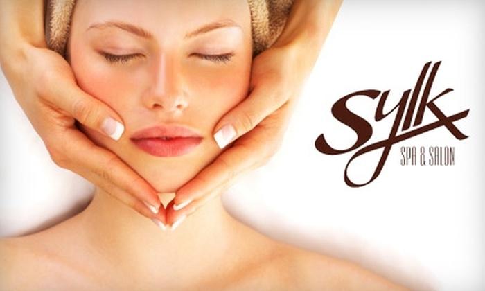 Sylk Spa & Salon - Perinton: $25 for Your Choice of a Hydrating Body Wrap or Facial Peel at Sylk Spa & Salon
