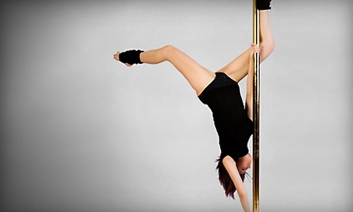 Women's Exotic Workout - Omaha: $35 for Three Exotic Pole-Dancing Classes ($75 Value) or $18 for Three Yoga Classes ($36 Value) at Women's Exotic Workout