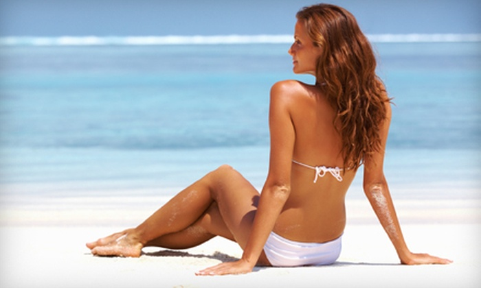 West Coast Tan of Naples - Urban Estates: One Month Of UV Tanning or One Airbrush Tan at West Coast Tan of Naples (Up to 53% Off)